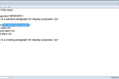 A picture of a user creating HTML bullet points in a simple web page created in Notepad.