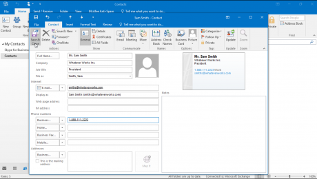 Manage Contacts in Outlook: A picture of a user saving editing changes to a contact in Outlook.