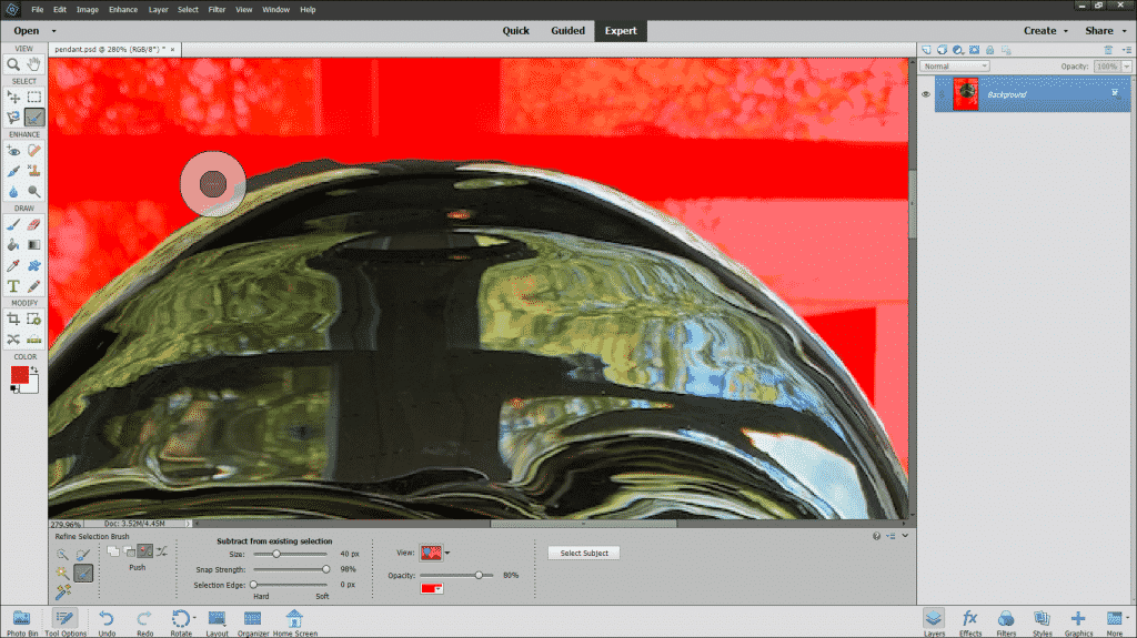 The Refine Selection Brush Tool in Photoshop Elements: A picture of the Refine Selection Brush Tool being used to add pixels to a selection.