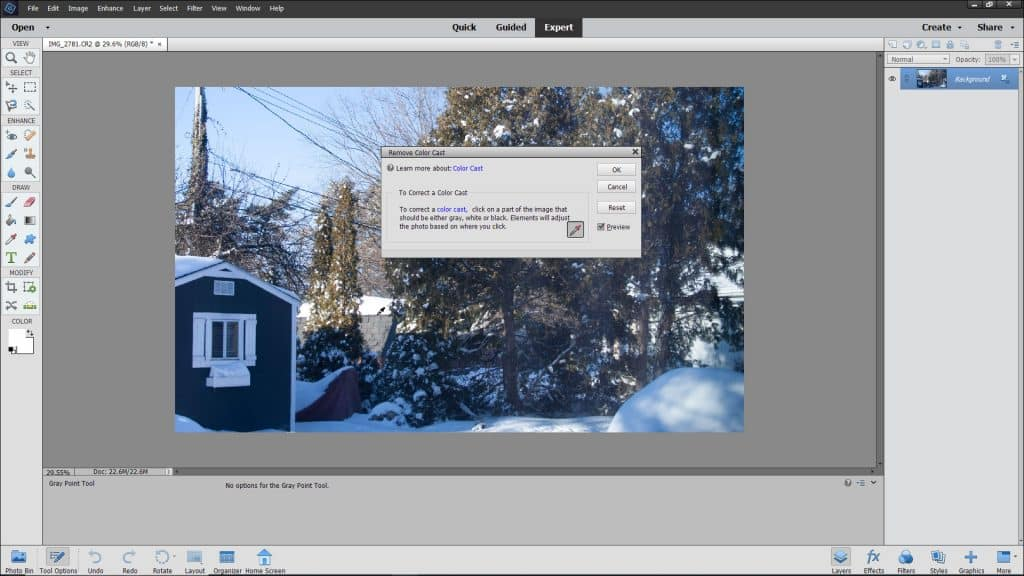 Remove a Color Cast in Photoshop Elements - Instructions: A picture of a user removing a color cast from an image in Photoshop Elements.