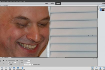 The Healing Brush Tool in Photoshop Elements- Instructions: A picture of a user correcting photo imperfections using the Healing Brush Tool in Photoshop Elements.