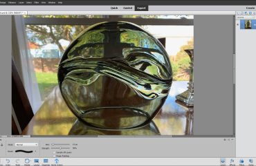 The Smudge Tool in Photoshop Elements- Instructions: A picture of a user applying the Smudge Tool in Photoshop Elements.
