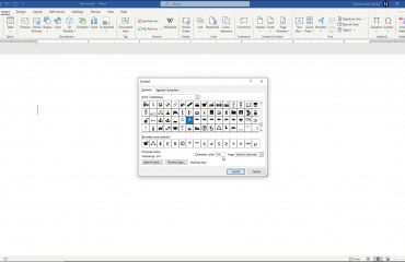 """Insert a Symbol in Word- Instructions and Video Lesson: A picture of a user adding a symbol to a document using the """"Symbol"""" dialog box in Word."""